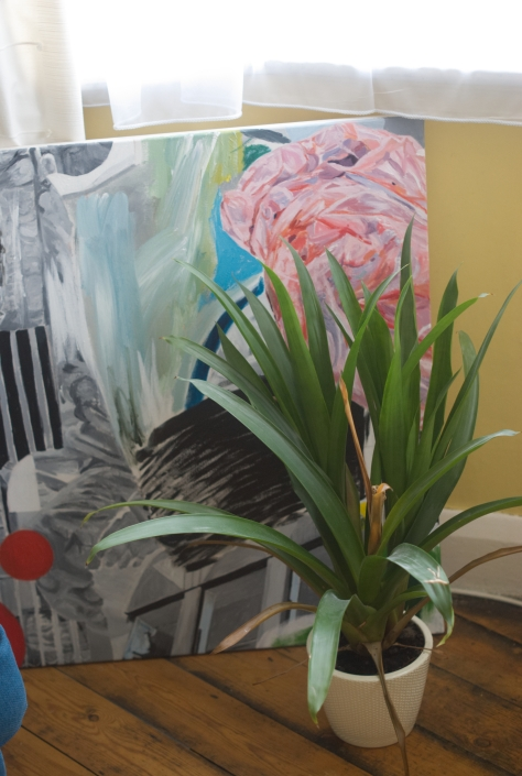 Painting in progress, plus plant